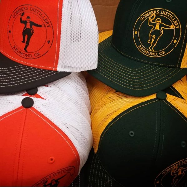 Gompers Distillery trucker hats in Oregon Ducks or Beavers colors